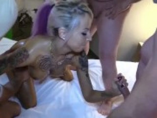 Beautiful blonde having group sex with several guys