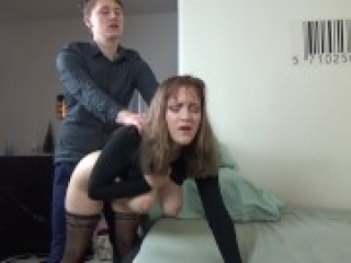 Young couple have rough clothed sex